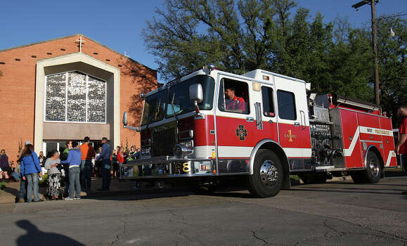 Members of West Volunteer Fire Department depart St. Mary's Catholic Church of the Assumption after a service honoring the department's fallen firefighters in West, Texas on Friday, Apr. 19, 2013. Five of the department's firefighters lost their lives in the West Fertilizer explosion on Wednesday. Photo: Kin Man Hui, San Antonio Express-News / ©2013 San Antonio Express-News