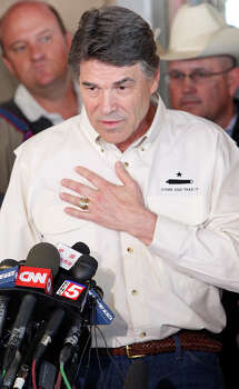 Gov. Rick Perry speaks ,Friday April 19, 2013, during a press conference on an explosion at a fertilizer plant that occurred Wednesday evening in West, Tx. Photo: Edward A. Ornelas, San Antonio Express-News / © 2013 San Antonio Express-News