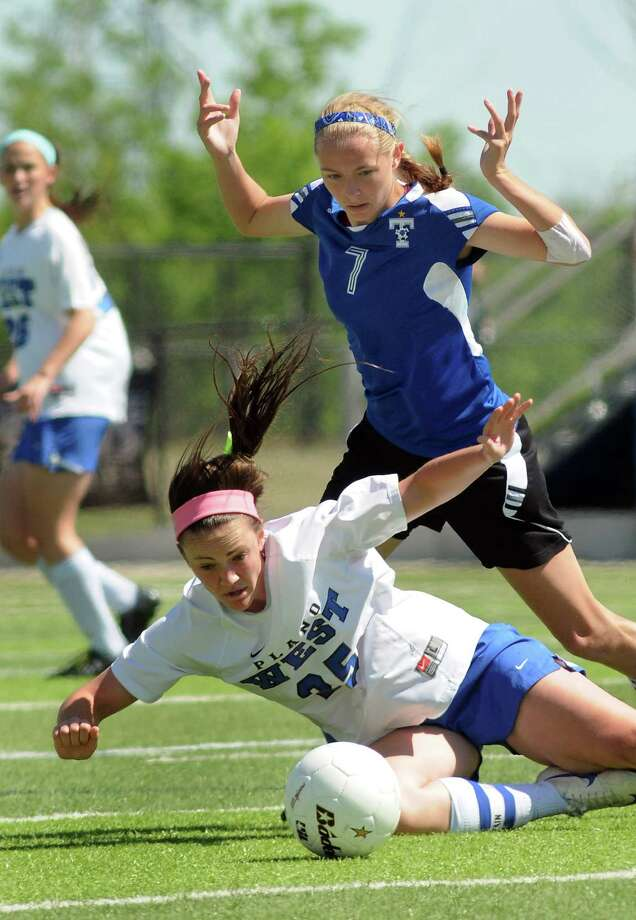 Katy Taylor senior forward Haley Silverberg (7) battles for the ball with Plano West senior midfielder Brooke Ramsier during their Class 5A semifinal at Birkelbach Field on Friday. Photo: Jerry Baker, Freelance