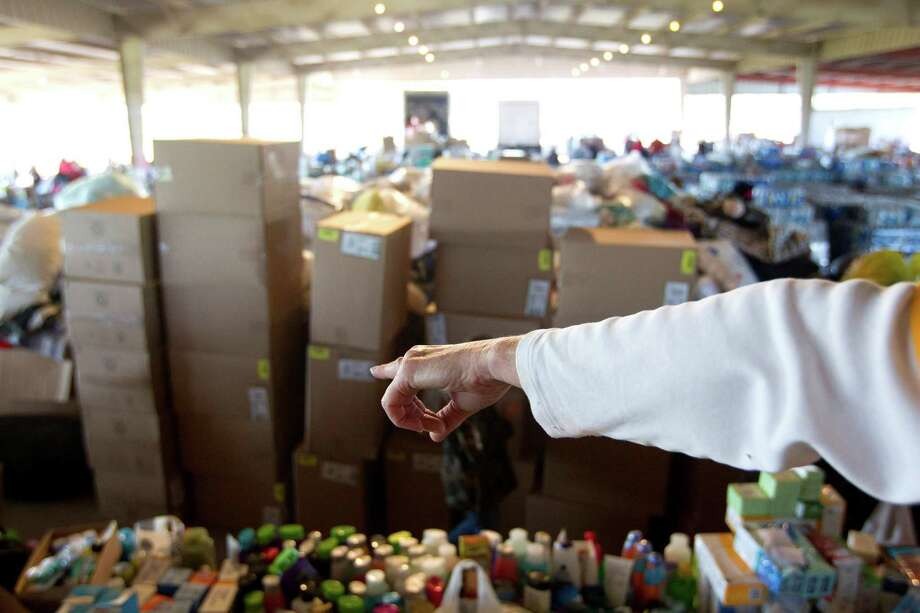 Volunteers organize donations Friday at the town's fairgrounds in West. A warehouse might be needed to store the overflow. Photo: Johnny Hanson, Staff / © 2013  Houston Chronicle