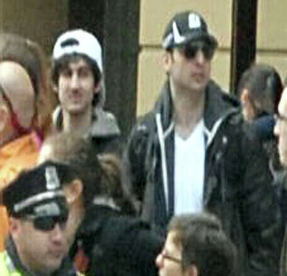 In an FBI handout photo, the two suspects in the Boston Marathon bombings walk together through the crowd during the marathon and before the blasts in Boston, April 15, 2013. Tamerlan Tsarnaev, a suspect in the blasts, was killed overnight in a standoff with police in Watertown, and a second suspect, Dzhokhar Tsarnaev, identified as his brother, was at large, a law enforcement official said. Photo: FEDERAL BUREAU OF INVESTIGATION, New York Times / FEDERAL BUREAU OF INVESTIGATION