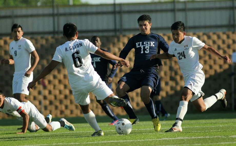 Elsik junior forward Andony Flores, center, battles a host of Brownsville Hanna defenders during their Class 5A semifinal matchup at Georgetown's Birkelbach Field on Friday. Photo: Jerry Baker, For The Chronicle