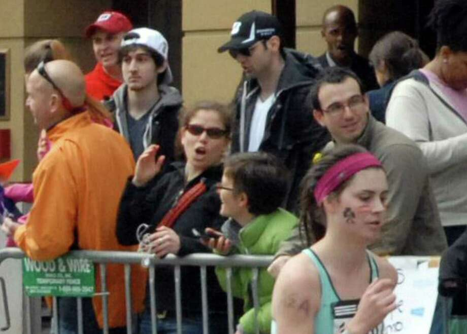 This Monday, April 15, 2013 photo provided by Bob Leonard shows second from left, Tamerlan Tsarnaev, who was dubbed Suspect No. 1 and third from left, Dzhokhar A. Tsarnaev, who was dubbed Suspect No. 2 in the Boston Marathon bombings by law enforcement.  This image was taken approximately 10-20 minutes before the blast. (AP Photo/Bob Leonard) Photo: Bob Leonard, STR / Courtesy of Bob Leonard