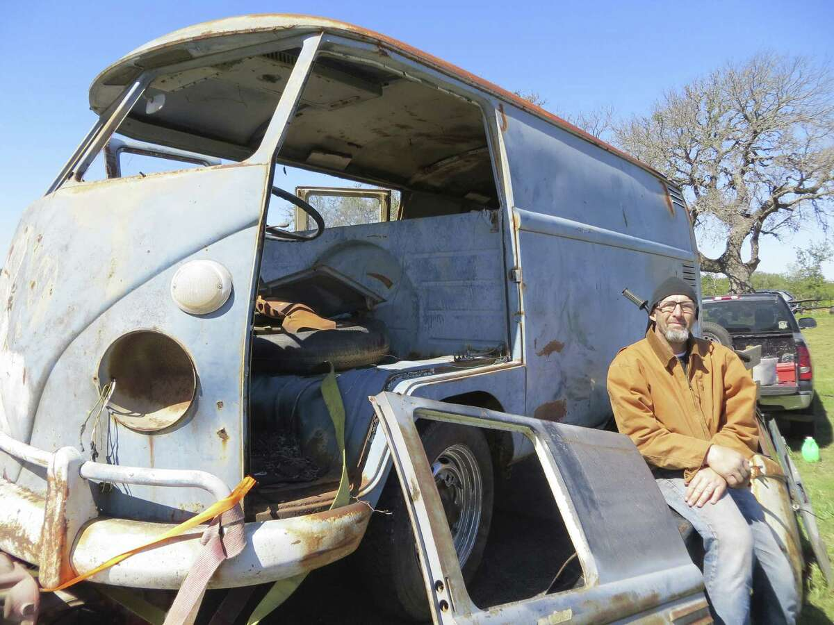 Conroe resident James King makes his living selling old VW Microbuses, like this 1962 model, priced at $4,000 despite lacking an engine, seats and other components.