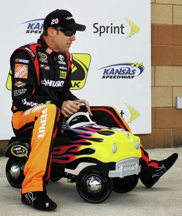 Matt Kenseth finds another set of hot wheels after qualifying first and winning the pole for Sunday's STP 400 Sprint Cup race at Kansas Speedway. Photo: Colin E. Braley, FRE / FR123678 AP
