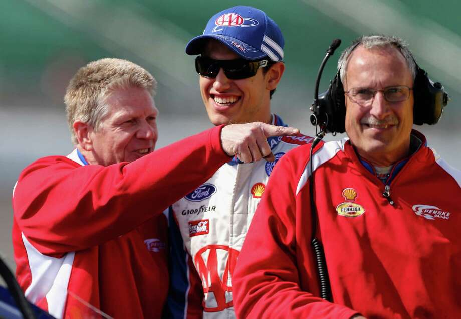 KANSAS CITY, KS - APRIL 19:  Joey Logano, driver of the #22 AAA Ford, talks with crew members during qualifying for the NASCAR Sprint Cup Series STP 400 at Kansas Speedway on April 19, 2013 in Kansas City, Kansas.  (Photo by Ed Zurga/Getty Images) Photo: Ed Zurga