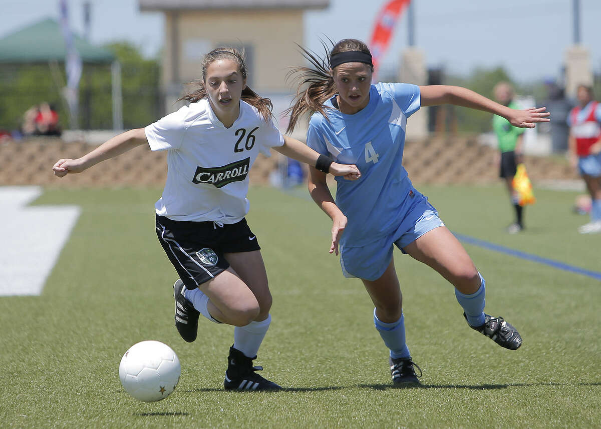 Johnson's Caitlin Schwartz (right) races to the ball against Southlake Carroll's Allie Luna on Friday in Georgetown. The Jaguars finished the season 21-5-3.