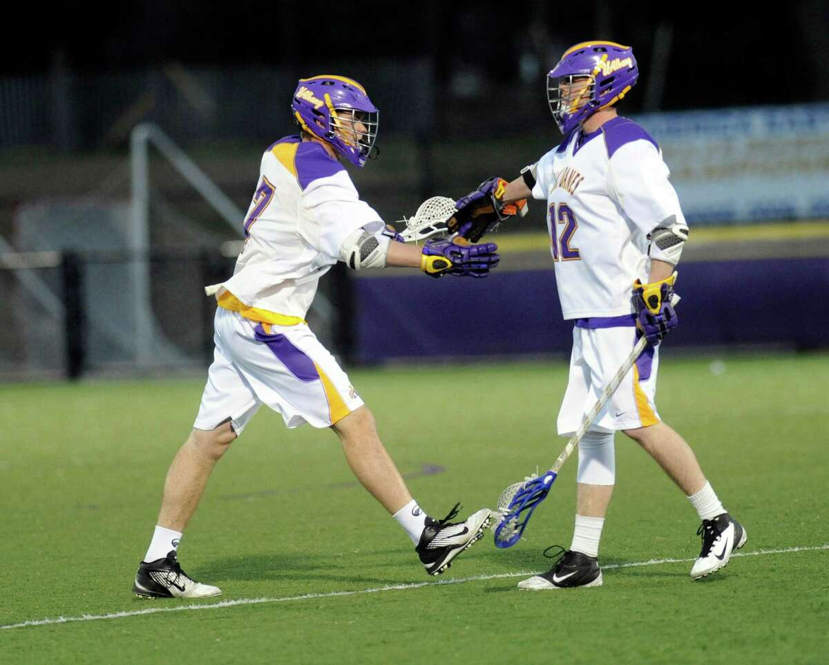 UAlbany's Will Fuller (7) and teammate Jimmy Haugen (12) celebrate a goal against UMBC during the first half of an NCAA men?s lacrosse game in Albany, N.Y., Friday, April 19, 2013. (Hans Pennink / Special to the Times Union)