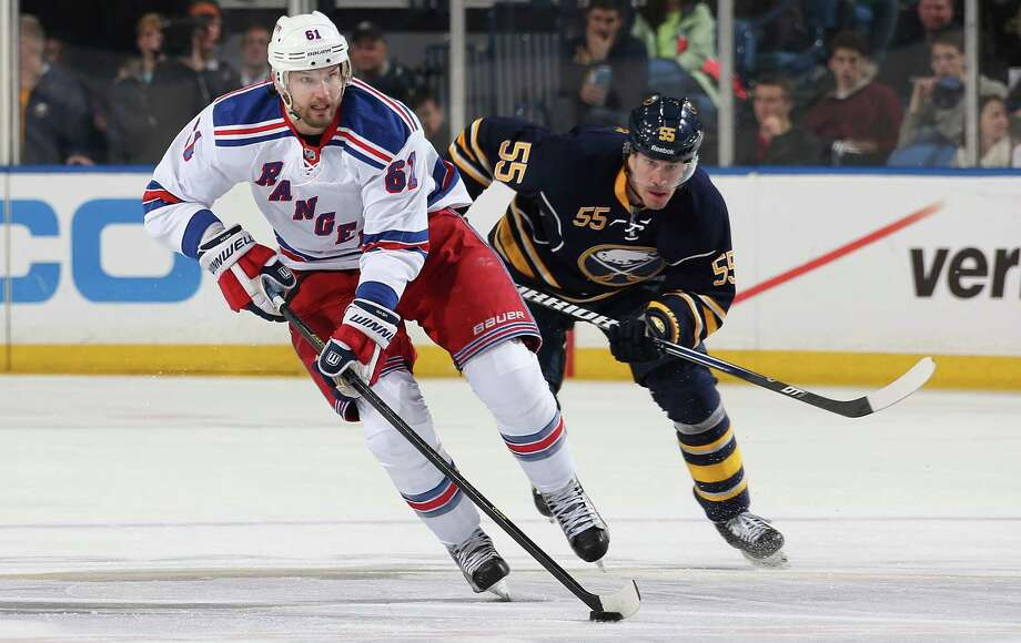 BUFFALO, NY - APRIL 19: Rick Nash #61 of the New York Rangers carries the puck up ice as Jochen Hecht #55 of the Buffalo Sabres follows from behind at First Niagara Center on April 19, 2013 in Buffalo, New York.  (Photo by Jen Fuller/Getty Images) Photo: Jen Fuller