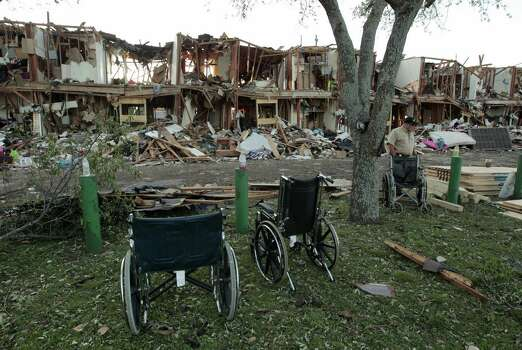 The remains of an apartment complex show the level of devastation next to the fertilizer plant that exploded Wednesday night. Buildings were damaged for blocks in every direction. It won't be easy to rebuild, longtime West residents said, and the tragedy of the explosion will linger. Photo: Erich Schlegel / Getty Images