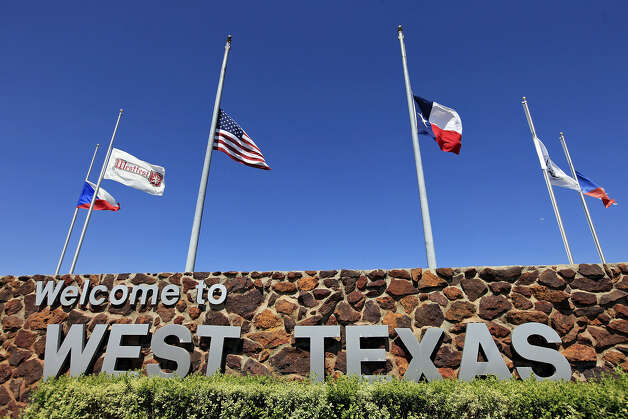 Flags are flown at half-staff Friday after the fertilizer plant explosion two days before. Photo: Edward A. Ornelas / San Antonio Express-News