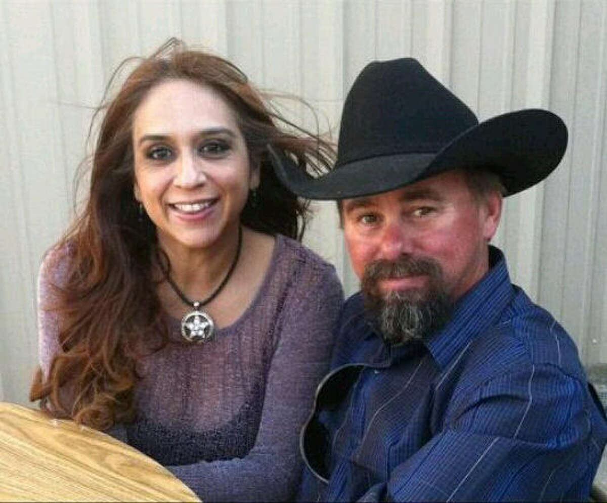 A 2012 photo provided by the Uptmor family shows Buck Uptmor and his wife, Arcy. Buck Uptmor, who rushed to the scene of the fire to help, was killed in the explosion.