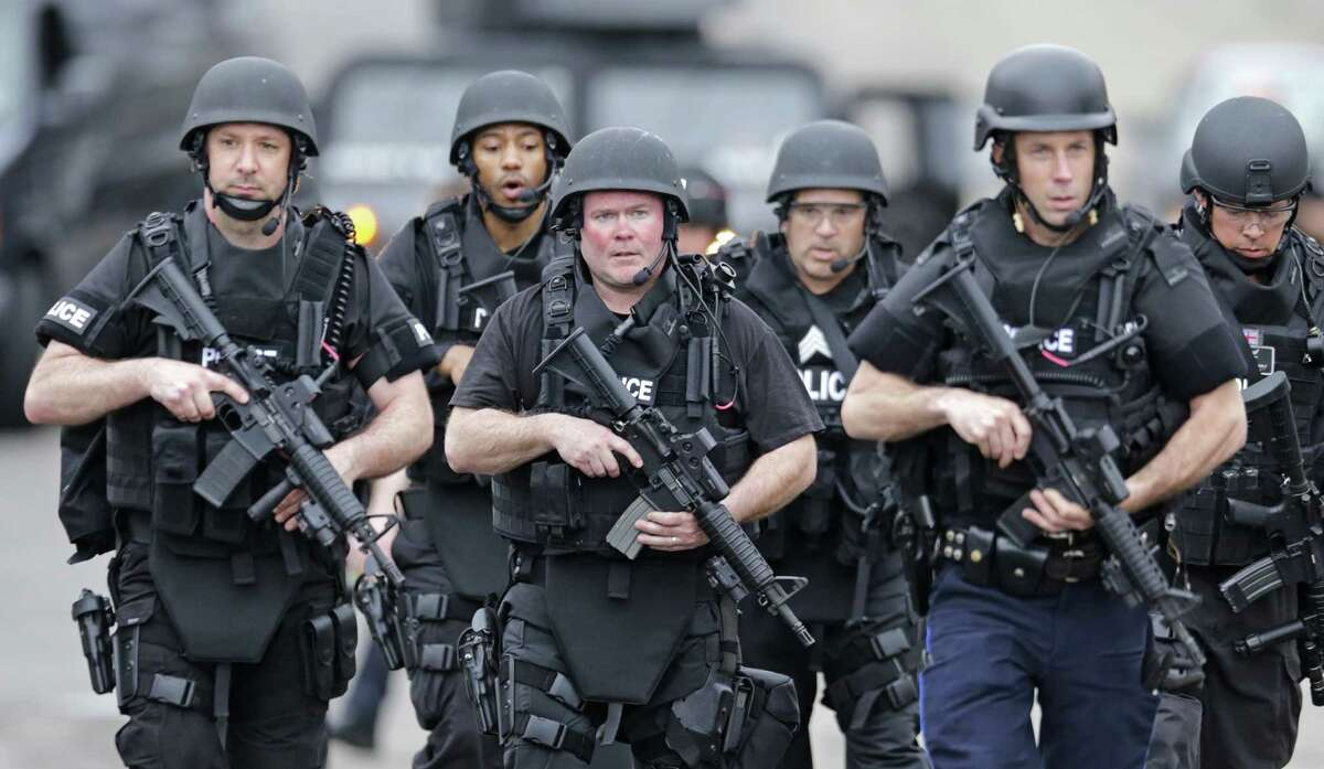 The SWAT team marched Friday through a Watertown, Mass., neighborhood in the search for Dzhokhar Tsarnaev, a suspect in the Boston Marathon bombing.