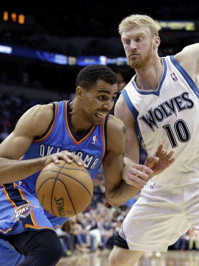 Oklahoma City Thunder guard Thabo Sefolosha, left Photo: Jim Mone, STF / AP