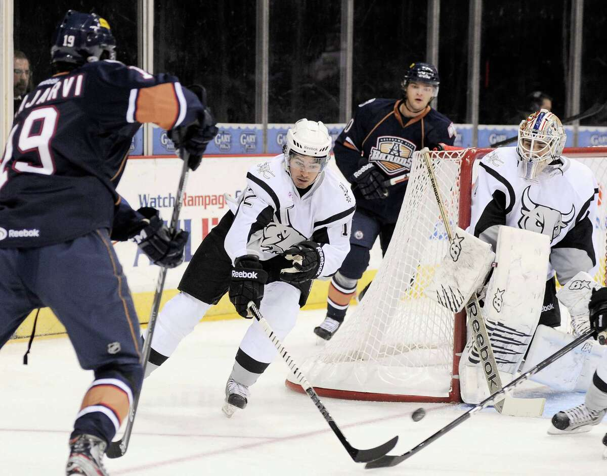 San Antonio Rampage center Jared Gomes (12) and Rampage goaltender Dov Grumet-Morris, right, defend the net against Oklahoma City Barons' Magnus Paajarvi, left, during the first period of an AHL hockey game, Sunday, Nov. 4, 2012, in San Antonio. (Darren Abate/pressphotointl.com)
