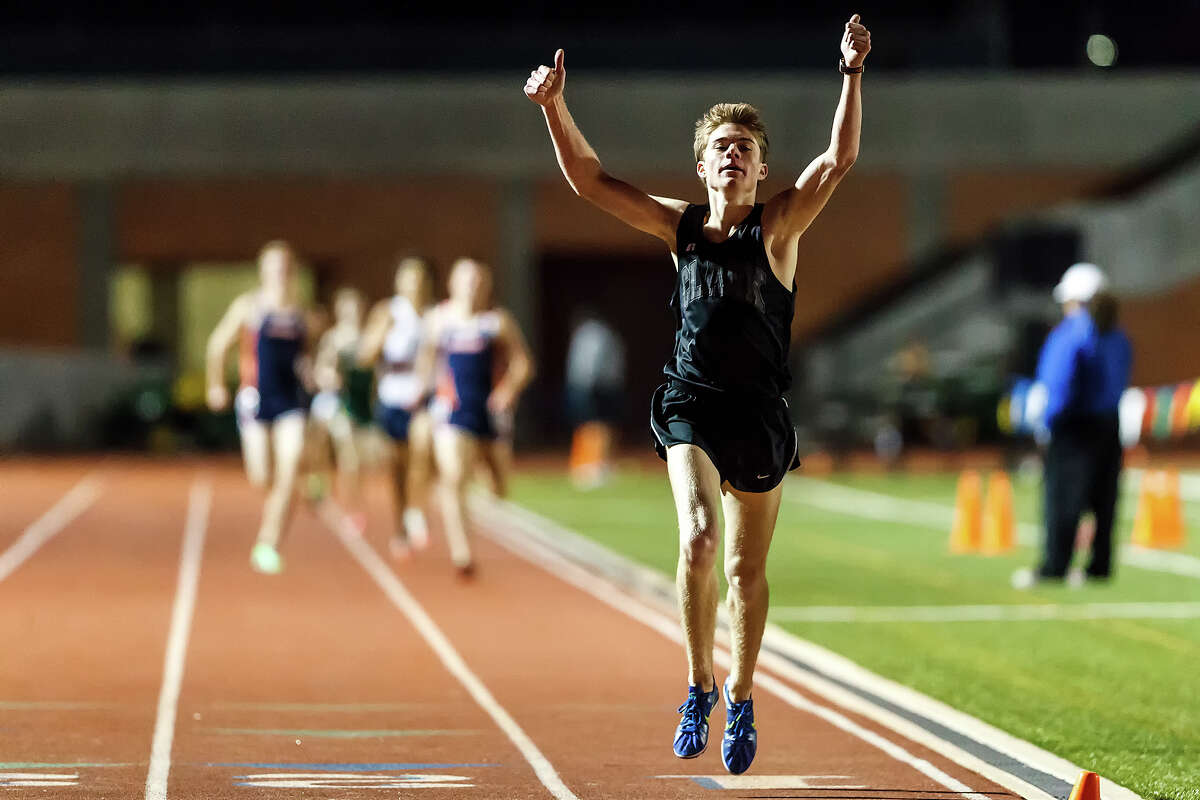 Clark's Austin Wells celebrates as he crosses the finish line in the boys 1600-meter run during the area 25-5A/26-5A and 27-5A/28-5A track meet at Heroes Stadium on Friday, April 19, 2013. Clark won the event in the 27-5A/28-5A meet with a time of4:21.93 and also took first place in the 3200-meter run. MARVIN PFEIFFER/ mpfeiffer@express-news.net
