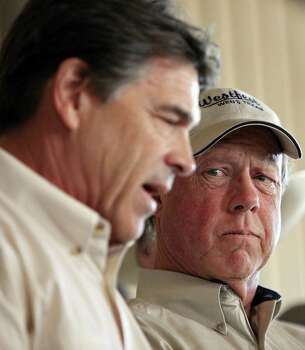 West Mayor Tommy Muska listens as Gov. Rick Perry talks about the disaster. Photo: Edward A. Ornelas / San Antonio Express-News