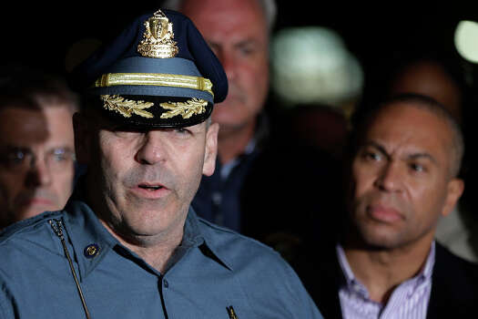 State Police Col. Timothy Alben, accompanied by Massachusetts Governor Deval Patrick, speaks during a news conference, after the arrest of a suspect of the Boston Marathon bombings in Watertown, Mass., Friday, April 19, 2013. A 19-year-old college student wanted in the Boston Marathon bombings was taken into custody Friday evening after a manhunt that left the city virtually paralyzed and his older brother and accomplice dead. (AP Photo/Matt Rourke)(AP Photo/Matt Rourke) Photo: Matt Rourke, Wire / AP2013