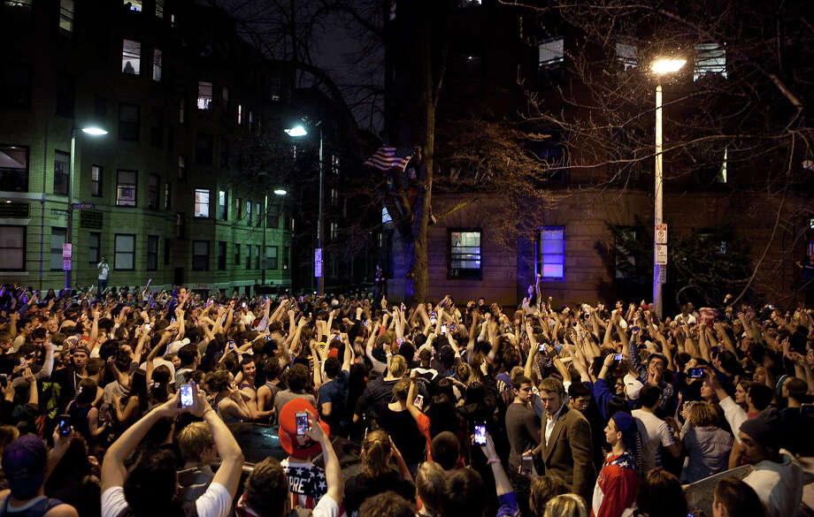 An estimated 200 people pour onto Hemingway Street in the Fenway neighborhood to celebrate after the announcement earlier of the capture of the second  Boston Martathon bombing suspect celebrate April 19, 2013 in Boston, Massachusetts. A manhunt for Dzhokhar A. Tsarnaev, 19, ended this evening with his capture on a boat parked on a residential property in Watertown, Massachusetts. His brother Tamerlan Tsarnaev, 26, the other suspect, was shot and killed by police early this morning after a car chase and shootout with police. The bombing killed three people and wounded at least 170.  Photo: Kayana Szymczak, Wire / 2013 Getty Images