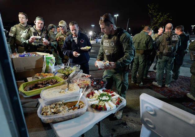 WATERTOWN, MA - APRIL 19:  Alcohol, Tobacco and Firearm police relax with a meal following the apprehension earlier of the second suspect in the Boston Marathon bombing on April 19, 2013 in Watertown, Massachusetts. A manhunt for a suspect in the Boston Marathon bombing, Dzhokhar A. Tsarnaev, 19, ended this evening with his capture on a boat parked on a residential property in Watertown, Massachusetts. His brother Tamerlan Tsarnaev, 26, the other suspect, was shot and killed by police early this morning after a car chase and shootout with police. The two men are suspects in the bombings at the Boston Marathon on April 15 that killed three people and wounded at least 170.  (Photo by Kevork Djansezian/Getty Images) Photo: Kevork Djansezian, Wire / 2013 Getty Images