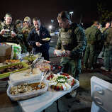 WATERTOWN, MA - APRIL 19:  Alcohol, Tobacco and Firearm police relax with a meal following the apprehension earlier of the second suspect in the Boston Marathon bombing on April 19, 2013 in Watertown, Massachusetts. A manhunt for a suspect in the Boston Marathon bombing, Dzhokhar A. Tsarnaev, 19, ended this evening with his capture on a boat parked on a residential property in Watertown, Massachusetts. His brother Tamerlan Tsarnaev, 26, the other suspect, was shot and killed by police early this morning after a car chase and shootout with police. The two men are suspects in the bombings at the Boston Marathon on April 15 that killed three people and wounded at least 170.  (Photo by Kevork Djansezian/Getty Images)