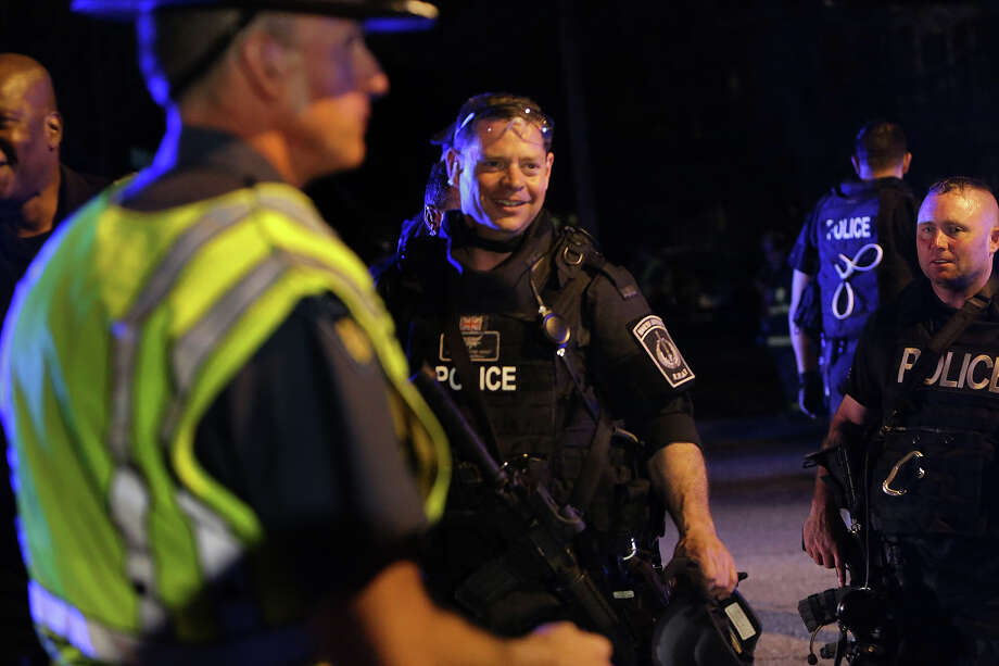 SWAT team members exit Franklin Street in Watertown with visible relief on their faces. After an intense manhunt and two-hour standoff in Watertown, law enforcement took a person into custody believed to be related to the Boston Marathon bombings.  Photo: Boston Globe, Wire / 2013 - The Boston Globe