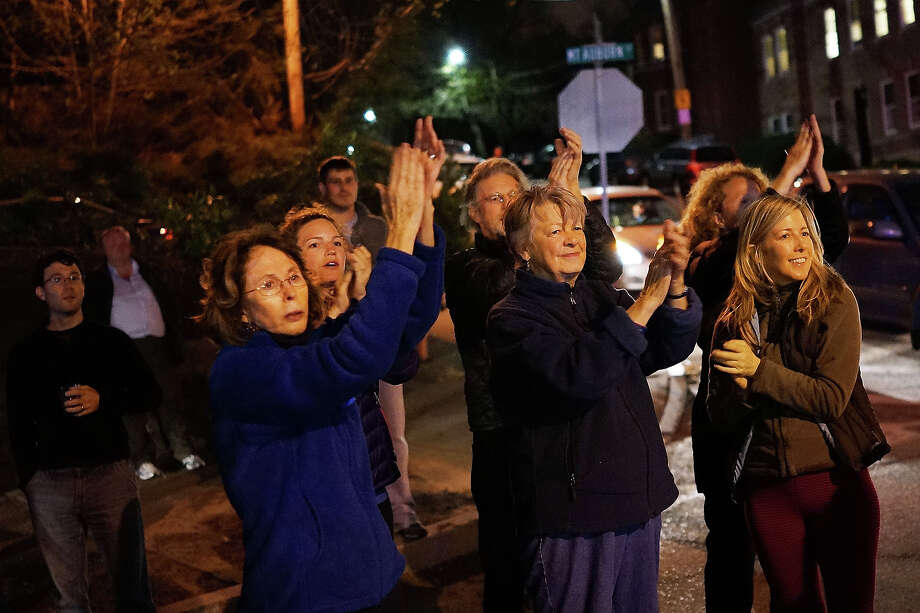 Women cheer police as they exit Franklin Street after 19-year-old bombing suspect Dzhokhar A. Tsarnaev  was apprehended on April 19, 2013 in Watertown, Massachusetts. A manhunt for Boston Marathon bombing suspect Tsarnaev ended this evening with his capture on a boat parked on a residential property in Watertown, Massachusetts. His brother Tamerlan Tsarnaev, 26, the other suspect, was shot and killed by police early this morning after a car chase and shootout with police. The two men are suspects in the bombings at the Boston Marathon on April 15 that killed three people and wounded at least 170. Photo: Spencer Platt, Wire / 2013 Getty Images