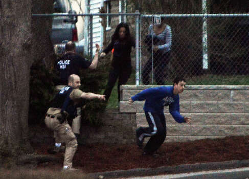 WATERTOWN, MA - APRIL 19: Residents flee from an area where a suspect is hiding on Franklin St., on April 19, 2013 in Watertown, Massachusetts. After a car chase and shoot out with police, one suspect in the Boston Marathon bombing, Tamerlan Tsarnaev, 26, was shot and killed by police early morning April 19, and a manhunt is underway for his brother and second suspect, 19-year-old Dzhokhar A. Tsarnaev. The two men are suspects in the bombings at the Boston Marathon on April 15, that killed three people and wounded at least 170.  (Photo by Darren McCollester/Getty Images) Photo: Darren McCollester, Wire / 2013 Getty Images