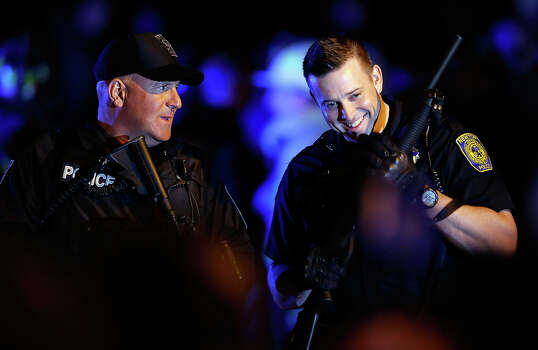 WATERTOWN, MA - APRIL 19:  Two police officers laugh while securing the area around Franklin Street on April 19, 2013 in Watertown, Massachusetts. A manhunt for a suspect in the Boston Marathon bombing, Dzhokhar A. Tsarnaev, 19, ended this evening with his capture on a boat parked on a residential property in Watertown, Massachusetts. His brother Tamerlan Tsarnaev, 26, the other suspect, was shot and killed by police early this morning after a car chase and shootout with police. The two men are suspects in the bombings at the Boston Marathon on April 15 that killed three people and wounded at least 170. (Photo by Jared Wickerham/Getty Images) Photo: Jared Wickerham, Wire / 2013 Getty Images