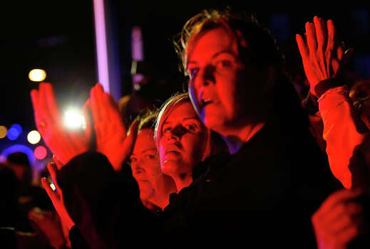 WATERTOWN, MA - APRIL 19:  Spectators clap and cheer while law enforcement members leave the scene near Franklin Street on April 19, 2013 in Watertown, Massachusetts. A manhunt for a suspect in the Boston Marathon bombing, Dzhokhar A. Tsarnaev, 19, ended this evening with his capture on a boat parked on a residential property in Watertown, Massachusetts. His brother Tamerlan Tsarnaev, 26, the other suspect, was shot and killed by police early this morning after a car chase and shootout with police. The two men are suspects in the bombings at the Boston Marathon on April 15 that killed three people and wounded at least 170. (Photo by Jared Wickerham/Getty Images) Photo: Jared Wickerham, Wire / 2013 Getty Images