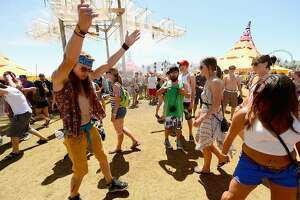 Attendees dance during the 2013 Coachella Valley Music & Arts Festival - Weekend 2 at the Empire Polo Club on April 19, 2013 in Indio, California.