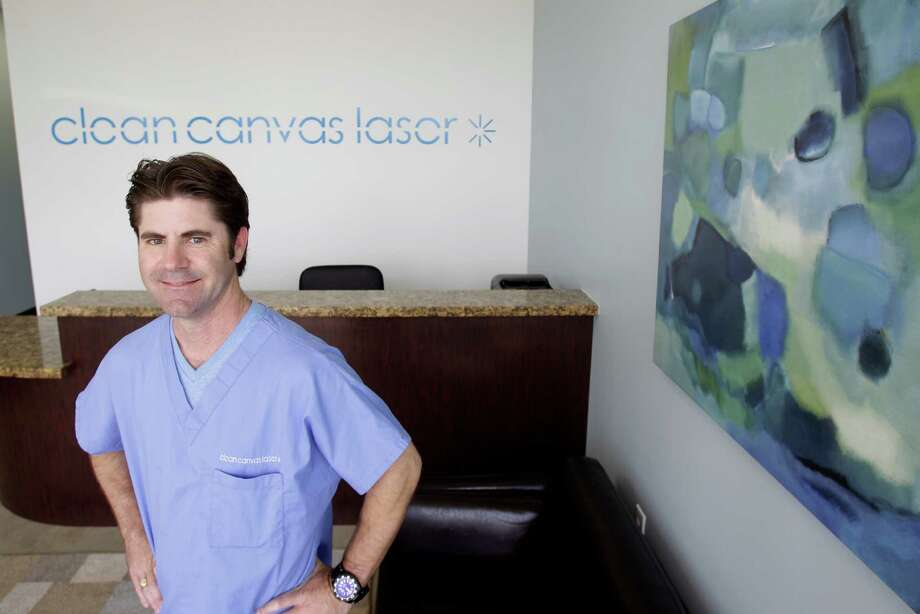 """I take off lots of names of lots of former flames,"" says John Hollis, the owner of Clean Canvas Laser Removal. Photo: Melissa Phillip, Staff / © 2013  Houston Chronicle"