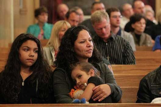 Families at the prayer service Photo: Mayra Beltran, Houston Chronicle / © 2013 Houston Chronicle