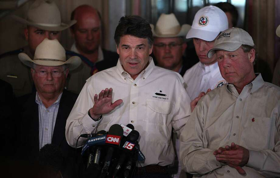 Gov. Rick Perry and other authorities address the media in West on Friday. Photo: Mayra Beltran, Houston Chronicle / © 2013 Houston Chronicle