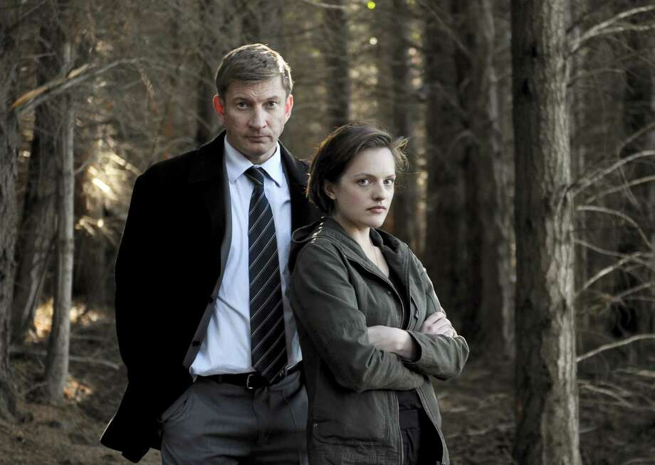 "This undated publicity image released by Sundance Channel shows David Wenham, left, and Elisabeth Moss in the Sundance Channel original miniseries ""Top of the Lake"". A TV miniseries and movie comeback will mean more Emmy Awards than expected at this year's ceremony. The TV academy's board of governors said it's reversing its 2012 decision to combine lead and supporting acting honors for such projects. In a statement, the board said that because of the ""unanticipated resurgence"" of TV miniseries and movies, it was reinstating the separate acting categories. The board was swayed by a rich field of potential contenders, including Elisabeth Moss and Holly Hunter in Sundance Channel's ""Top of the Lake"" and Ben Whishaw and Dominic West in BBC America's ""The Hour."" (AP Photo/Sundance Channel, Parisa Taghizadeh) Photo: Parisa Taghizadeh"