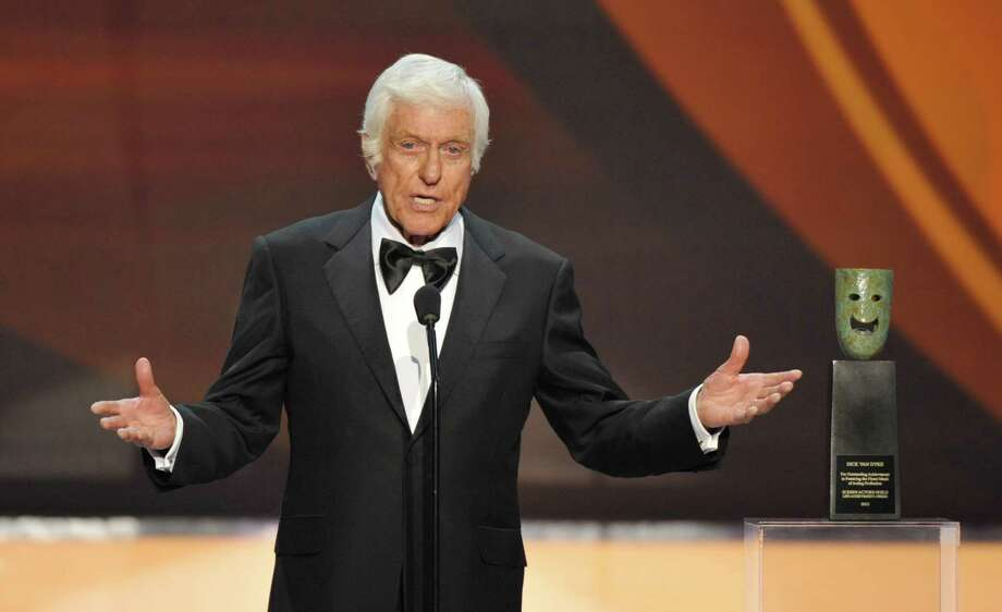 "FILE - This Jan. 27, 2013 file photo shows Dick Van Dyke on stage at the 19th Annual Screen Actors Guild Awards at the Shrine Auditorium in Los Angeles. Van Dyke is undergoing tests for ""cranial throbbing"" that's causing him to lose sleep. Spokesman Bob Palmer said Thursday the 87-year-old Van Dyke has been experiencing a throbbing sensation in his head when lying down. Scans and other tests have yet to yield a diagnosis, Palmer said. (Photo by John Shearer/Invision/AP, file) Photo: John Shearer"