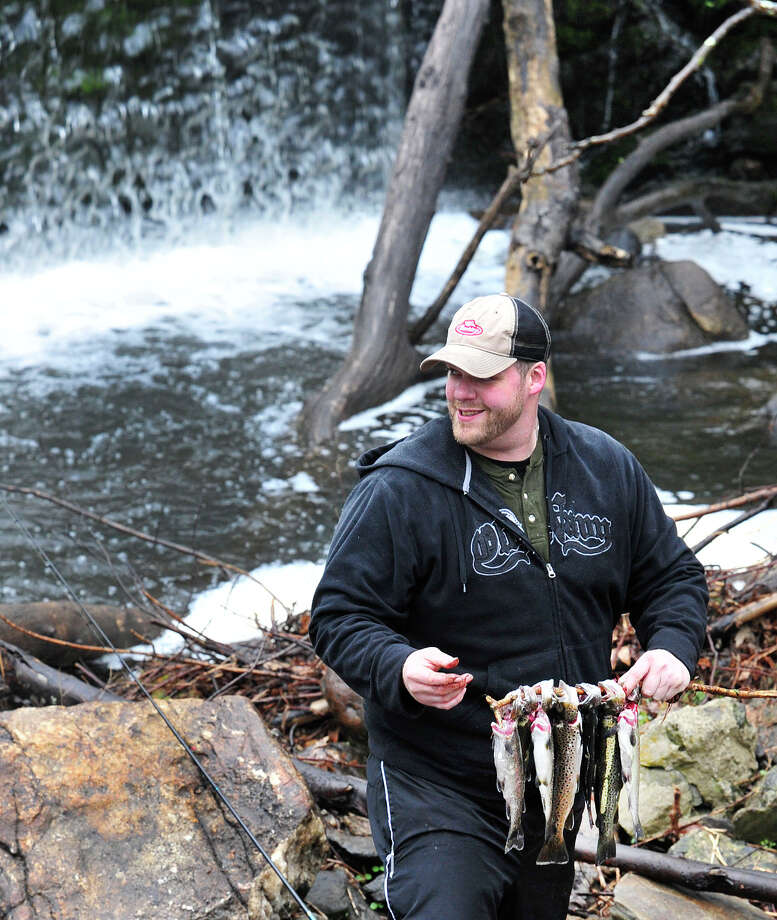 Chris Braun, of New Milford,  holds his catch on the opening day of fishing season along the Saugatuck River in Redding, Conn. Saturday, April 20, 2013. Photo: Michael Duffy / The News-Times