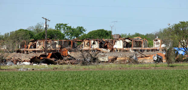 The remains of a building ,Saturday April 20, 2013, after an explosion at a fertilizer plant that occurred Wednesday evening in West, Tx. Photo: Edward A. Ornelas, San Antonio Express-News / © 2013 San Antonio Express-News