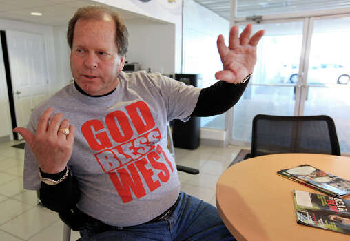 "Greg May Chevrolet used car manager Ronnie Owens wears a ""God Bless West"" t-shirt ,Friday April 19, 2013, that is being sold at the dealership after an explosion at a fertilizer plant that occurred Wednesday evening in West, Tx. The money raised from the t-shirt is benefitting the West Independent School District. Photo: Edward A. Ornelas, San Antonio Express-News / © 2013 San Antonio Express-News"