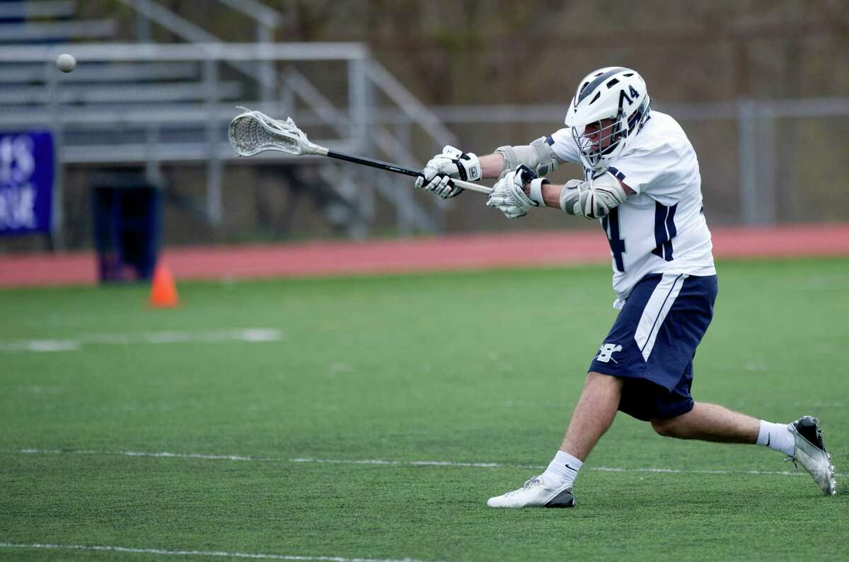Staples' Patrick Lesch scores a goal during Saturday's lacrosse game against New Canaan in Westport, Conn., on April 20, 2013.