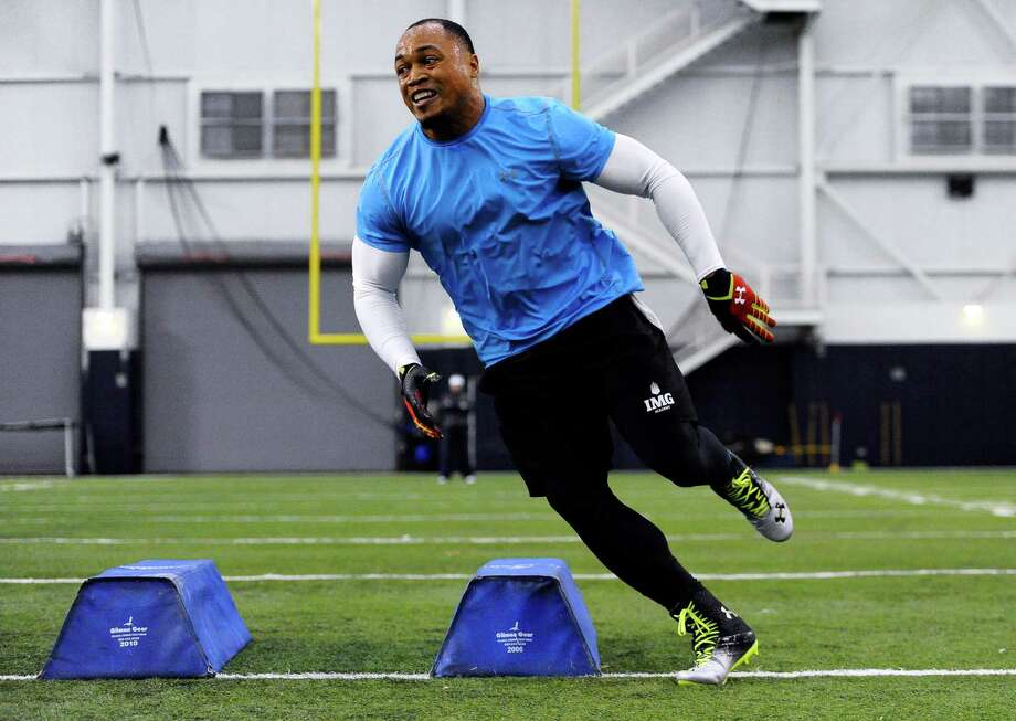 Defensive end Trevardo Williams runs a drill in a workout during Connecticut's NFL football pro day in Storrs, Conn., Wednesday, March 27, 2013. (AP Photo/Jessica Hill) Photo: Jessica Hill, Associated Press / FR125654 AP