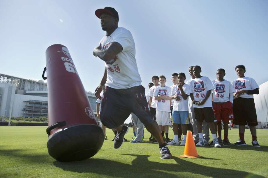 Andre Johnson works on drills with young athletes Saturday at the Methodist Training Center at Reliant Park.
