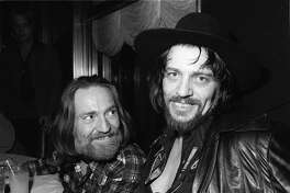 FILE--Waylon Jennings, right, and Willie Nelson are shown in this January 1978 file photo. Jennings, who defined the outlaw movement in country music, died Wednesday, Feb. 13, 2002, at his home in Arizona, after a long battle with diabetes-related health problems. He was 64. (AP Photo/File)