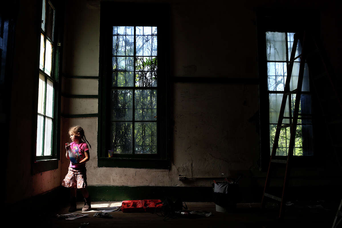 Carolynn Day, 4, cleans windows in Pump House No. 1, a historic building at Brackenridge Park, as part of the Earth Day activities at the park, in San Antonio on Saturday, April 20, 2013. Day is the daughter of Leilah Powell, the Executive Director of the Brackenridge Park Conservancy.