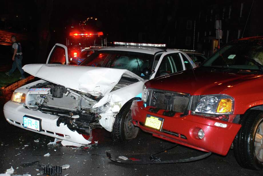 An Albany police cruiser, left, was damaged by an allegedly drunk driver. (Thomas Heffernan Sr./Special to the Times Union)