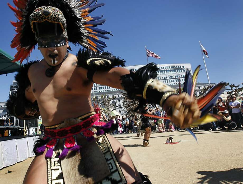 Armando Torres and the Yaocuauhtli Aztec Dancers perform for the crowd at the annual Earth Day festival on Civic Center Plaza in San Francisco, Calif. on Saturday, April 20, 2013. Photo: Paul Chinn, The Chronicle