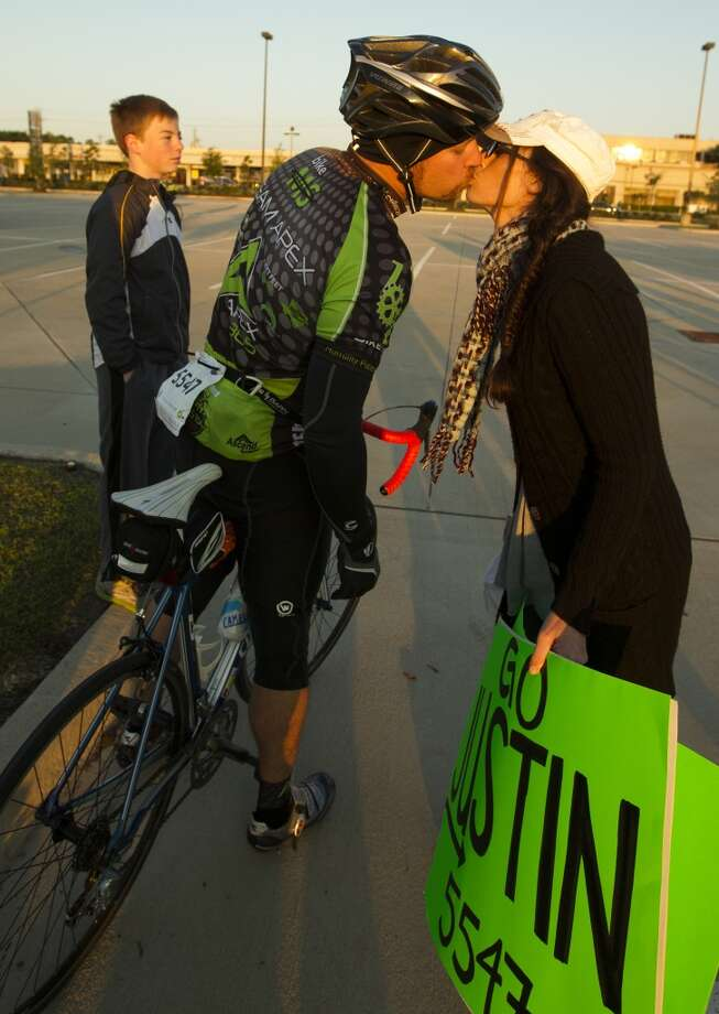 Justin Shulse kisses his wife Jennifer goodbye as he begins his journey from Tully stadium to Austin during the BP MS 150 on Saturday, April 20, 2013, in Houston.