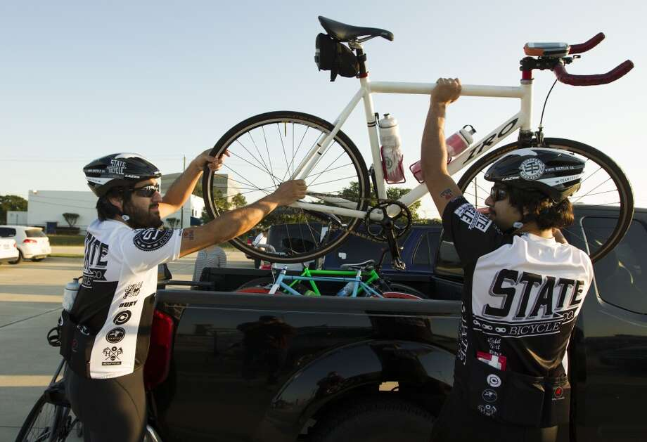 Jay Alzeerah, left, and his brother Milad unload their bikes as they prepare to begin their journey from Tully stadium, one of three starting points, to Austin during the BP MS 150 on Saturday, April 20, 2013, in Houston. This is the brothers\' first time to participate in the event.