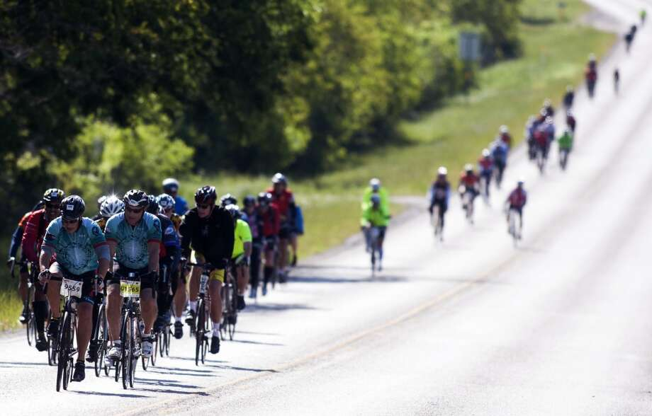 Cyclists ride along FM 529 towards Bellville on route to Austin during the BP MS 150 on Saturday, April 20, 2013, in Houston.