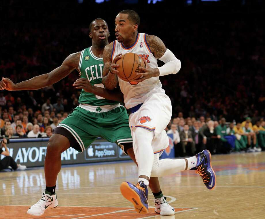 New York Knicks guard J.R. Smith, right, drives past Boston Celtics forward Jeff Green (8) during the first half of Game 1 in the first round of the NBA basketball playoffs at Madison Square Garden in New York, Saturday, April 20, 2013.  (AP Photo/Kathy Willens) Photo: Kathy Willens, Associated Press / AP
